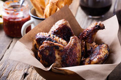 Smoky barbecued chicken wings Royalty Free Stock Photos
