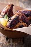 Smoky barbecued chicken wings Stock Photo