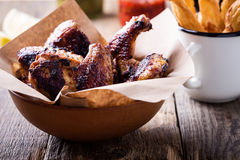 Smoky barbecued chicken wings Stock Photography
