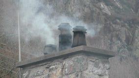 Smoky chimneys in Beddgelert, Wales stock video footage