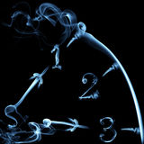 Smoky clock on black Royalty Free Stock Photo