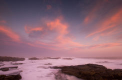 Smoky cloudscapes. Scenery of a seascape at sunset with rising waters Royalty Free Stock Photo