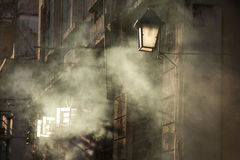 Smoky evening. Smoke billowing from a building at sunset in havana, cuba royalty free stock photo