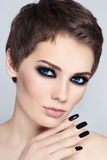 Smoky eyes and black nails Royalty Free Stock Images