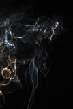 Smoky fantasy. Th photo show the abstract - smoke on the black Stock Photos