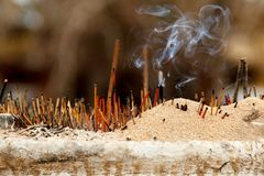 Smoky joss sticks in a buddhist temple royalty free stock photos