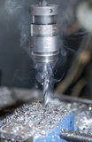 Smoky metal drill Stock Images