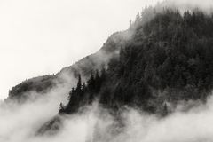 Fog covering the mountain forests with low cloud in Juneau alaska for fog landscape Royalty Free Stock Photo