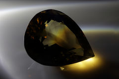 Smoky quartz. Smoky topaz. Cut stone Royalty Free Stock Image