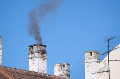 Smoky Residential Chimneys Royalty Free Stock Images