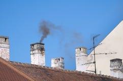 Smoky Residential Chimneys Royalty Free Stock Photo