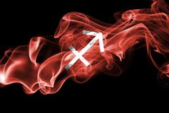 Smoky Sagittarius zodiac astrology sign for horoscope. Isolated on a black background Stock Image