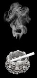 Smoky skull above an ashtray Royalty Free Stock Images