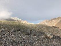 Smoky and snow-capped Mountains. Snow covered mountains called anti-taurus, aka, Aladaglar in Kayseri, Turkey stock image