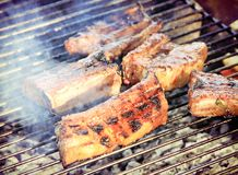 Smoky spare ribs on a grill Stock Photography