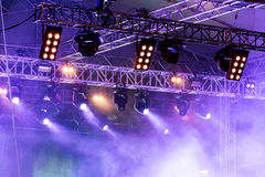 Smoky stage illuminated with blue spot lightning system during c Stock Photo