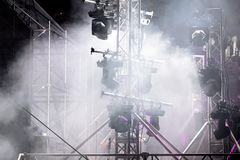 Smoky stage illuminated with spotlight system during concert Stock Photography