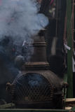 Smoky stove. A smoking oven on a  Carnival venturing Royalty Free Stock Photos
