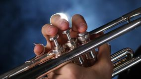 The smoky studio with lighting playing trumpet stock video footage