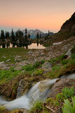 Smoky sunset in the Wasatch Mountains. Smoky sunset clouds at Silver Lake, Utah, USA Royalty Free Stock Photography