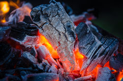 Smoldering ashes. Burning coal. BBQ barbecue. Smoldering ashes of charcoal. BBQ barbecue Stock Image