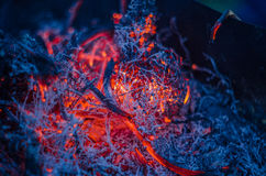 Smoldering ashes in the fire. Dark smoldering ashes in the fire Royalty Free Stock Photos