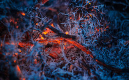 Smoldering ashes in the fire. Dark smoldering ashes in the fire Royalty Free Stock Photography