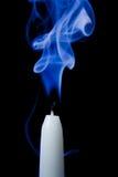 Smoldering candle Stock Image