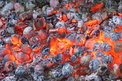 A smoldering coal fire. Bright background of black and red colors. Landscape Stock Image
