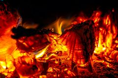 Smoldering coals close-up, bright, hot flame in the furnace stock image