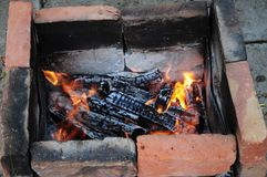 Free Smoldering Cracked Firewood With Orange Color Flames Among Ashes. Terracotta Red And Smoky Black Charred Bricks Stock Photos - 148835953