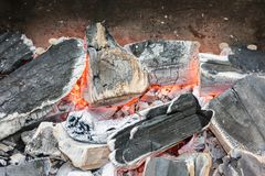 Smoldering embers of fire. Smoldering coals, an extinct barbecue fire Stock Image