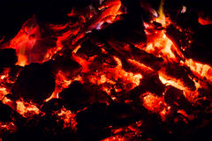 Smoldering fire, the fading fire, embers, sparks, flame, ash, wood. Macro. Stock Images
