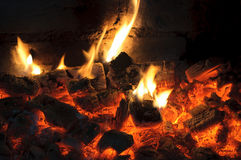 Smoldering fire and flames wood. The smoldering fire and flames wood Stock Photography