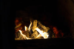 Smoldering fire. In the oven and dark background Stock Images