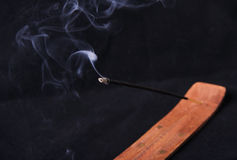 Smoldering incense stick. On a stand Royalty Free Stock Photos