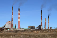 Smoldering pipe working plant pollute the atmosphere of the eart. H Stock Images