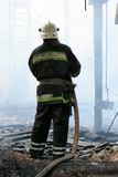 Firefighters extinguish a fire in an apartment house Stock Image