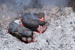 Smoldering sunflower shell biomass briquettes. With more smoke royalty free stock images
