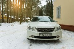 New luxury Toyota Camry parked in suburbia at winter evening. Royalty Free Stock Image