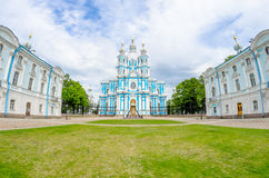 Smolny Cathedral and the lawn in front of him square in St. Petersburg. Royalty Free Stock Photos