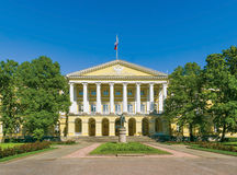 Smolny Institute Building. Facade of the Smolny Institute (the official residence of the governor of St.Peterburg now) with a Lenin statue in the foreground royalty free stock photos