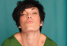 Smooch. Face shot of a caucasian female showing expression Royalty Free Stock Images