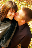 Smooching and Sweet. Very attractive couple in love posing for portraits Royalty Free Stock Photos