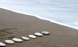 Smooth beach stones in a row Royalty Free Stock Image