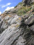 Smooth big high mountain rock covered with grass royalty free stock photos