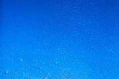Smooth blue color water drops abstract background royalty free stock photography