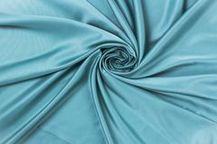 Smooth elegant silk or satin luxury cloth texture can use as abstract background stock photo