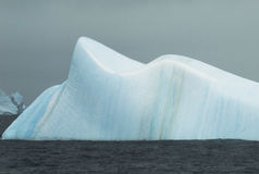 Smooth blue iceberg Stock Image