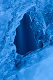 Smooth blue wall of ice with a window Royalty Free Stock Photography